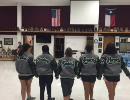 Excited Students Receive Letter Jackets