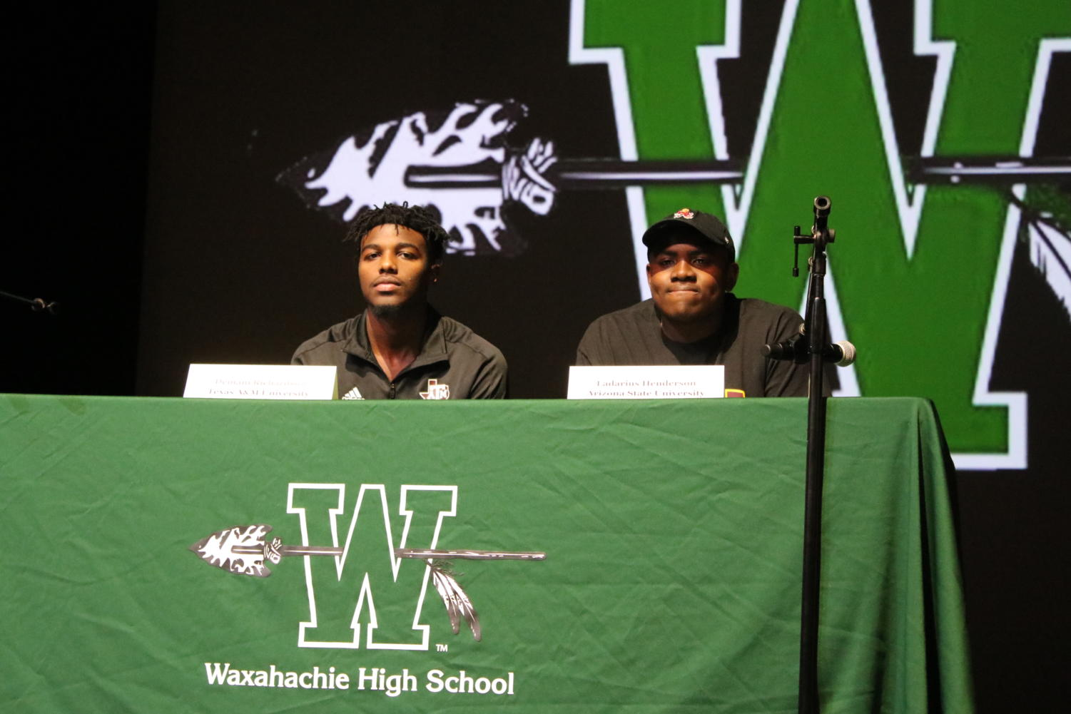Seniors Demani Richardson and Ladarius Henderson sign their Letters of Intent Wednesday in the PAC.