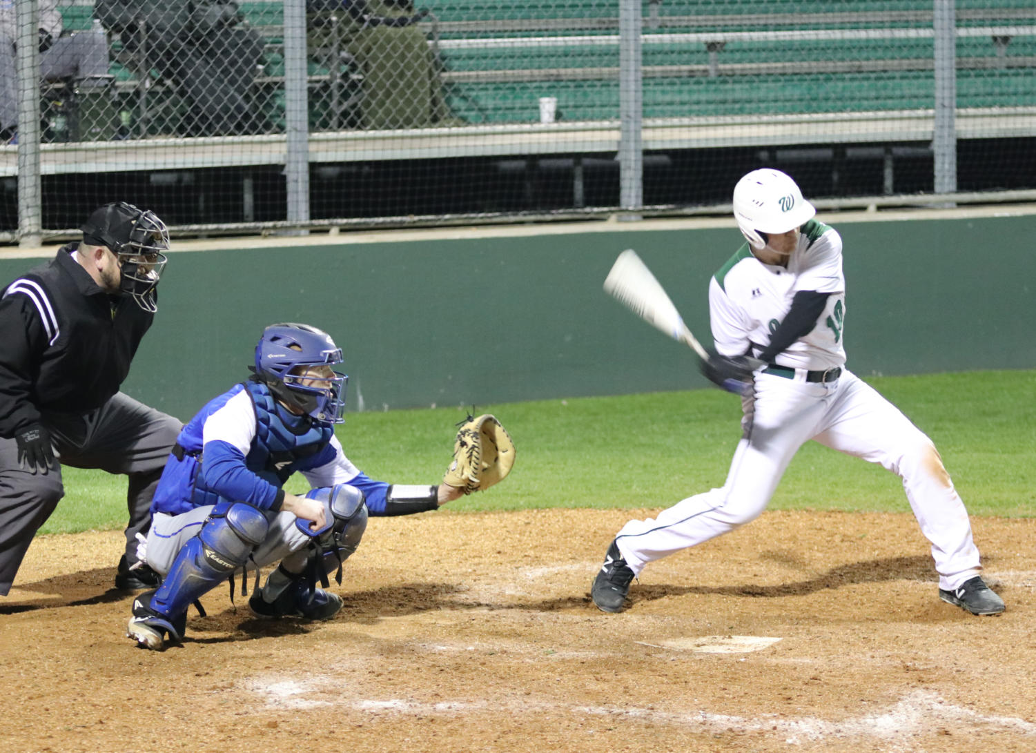 Jordan Fay takes a swing in the Indians' loss to Bryant (AR) High School.