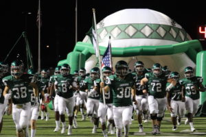 The Indians enter the field in their win over Mesquite Poteet.