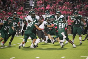 The Indian defense makes a stop in the Pink Out loss to DeSoto.